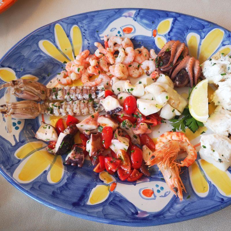 Mangiare del buon pesce fresco con gli occhi al cielo: Fly Restaurant Al Lido